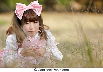 japanese lolita in meadow - japanese woman in sweet lolita...