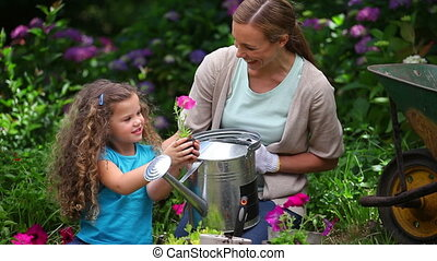 Daughter showing a flower to her mother