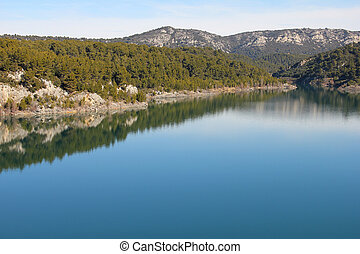 Mountain landscape with blue river, in Provence, France