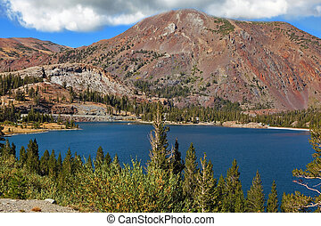 Picturesque  red mountain on coast of lake