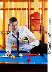 Billiard handsome player man drinking alcohol