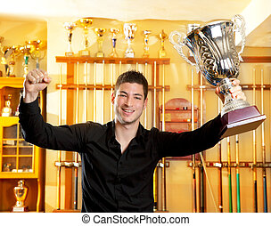 Happy proud winner man with big trophy silver cup in...
