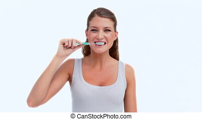 Woman using a toothbrush against white background