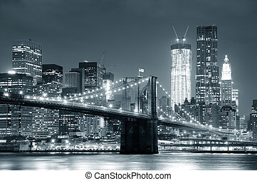 New York City Brooklyn Bridge black and white with downtown...
