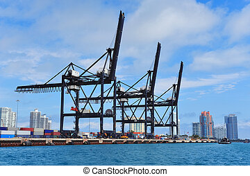 Miami harbor - Crane at Miami harbor with blue sky over sea.