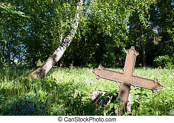 abandoned cemetery with a rusty iron cross on the front