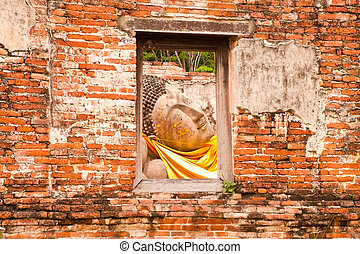 Sleeping Buddha Statue in Window at Wat Putthaisawan Temple...