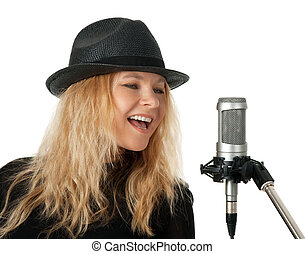 Singer in black hat singing with the microphone