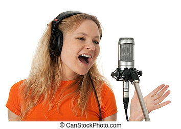 Singer in headphones singing with the microphone