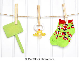 Baby Goods and Blank Sign on a Clothesline