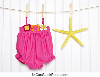 Baby Bathing Suit and Starfish on a Clothesline