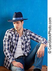 handsome man with plaid shirt and cowboy hat - handsome...