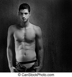Black and white sexy young denim shirtless man on retro...