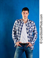 handsome young man with plaid shirt denim jeans in blue...