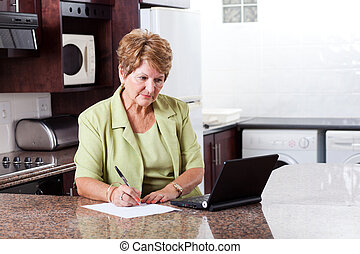 senior woman doing home finance