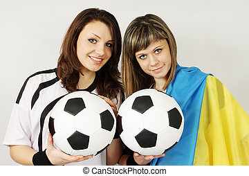 football fans - two beautiful football fans hold the balls