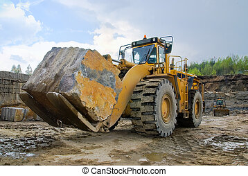 Excavation with a big stone in a granite quarry