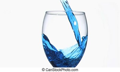 Blue trickle in super slow motion flowing in a wineglass