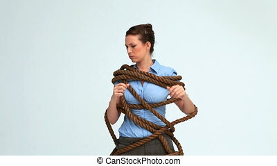 Woman attached with a rope in studio