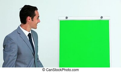 Businessman giving a presentation on a board