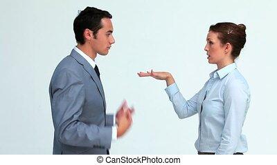 Colleagues arguing in studio