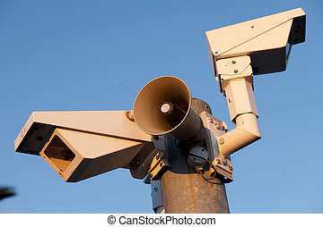 Security cameras and warning loudspeaker in afternoon