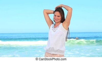 Woman shaking her hair out at the beach