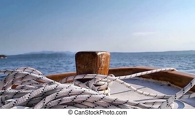 Boat at anchor - Wooden boat at anchor on blue sea