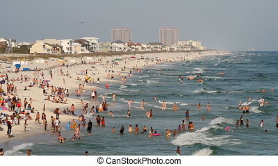Pensacola Beach Tourists - Tourists wade, swim and sunbath...