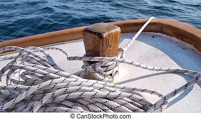 Small wodeen boat at anchor