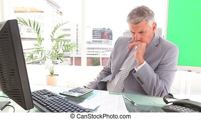 Annoyed businessman contemplating in an office