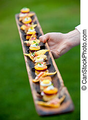appetizers served by a waiter