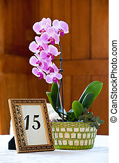 Orchid centerpiece - A purple orchid flower centerpiece with...