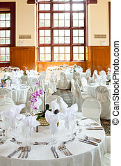 Wedding tables with  and orchid centerpiece