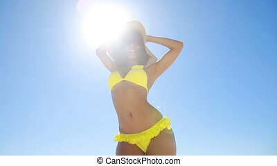 Woman in a yellow bikini