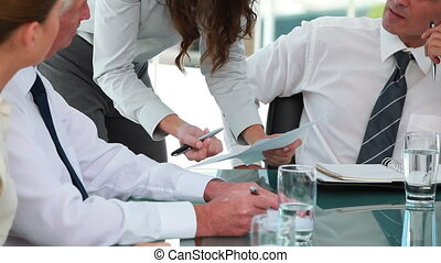 Businesswoman giving information during a meeting