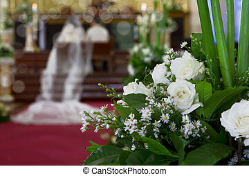 Wedding on a church with romantic white roses