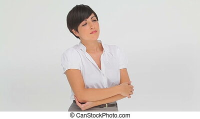 Businesswoman contemplating alone against a white background