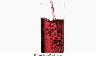 Thin red liquid in a super slow motion flowing in a glass...