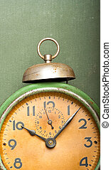 vintage green alarm clock vertical banner with copy-space