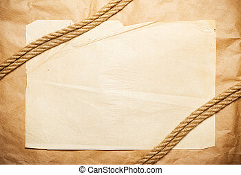 yellow paper background with rope over it