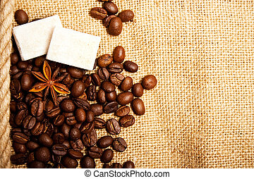 coffee spices - beans, anisetree and lump sugar on sacking