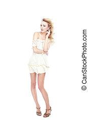 White fashion - Elegant blond in white dress on a studio...