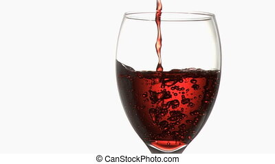 Red trickle in super slow motion flowing in a wineglass