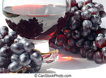 grape juice in the glass and ripe grapes
