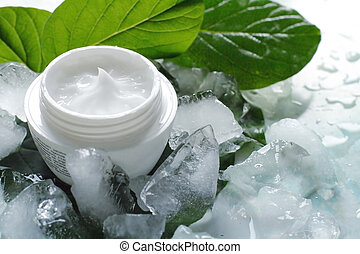 Cosmetic creams - A jar of a cosmetic cream with fresh green...