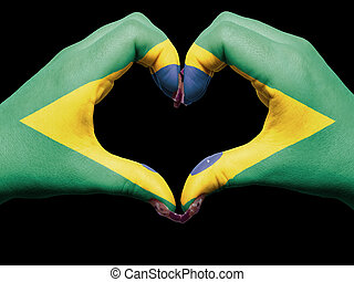 Gesture made by brazil flag colored hands showing symbol of...