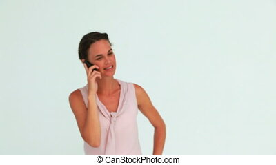 Well-dressed woman on the phone against white background