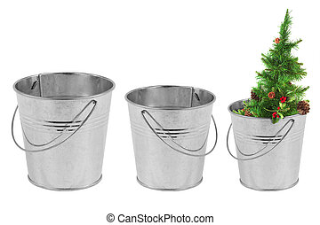 Three metal bucket and a Christmas tree on a white...