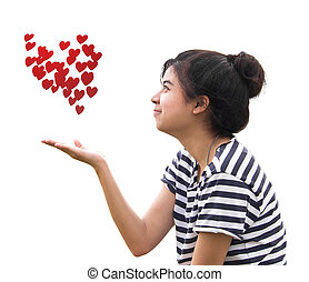 Romantic young woman holding a red heart in hands